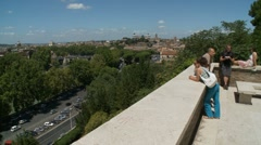 Tourists take in view of Rome from Orange Garden Stock Footage
