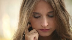 Attractive Young Adult Woman in Pensive Mood Stock Footage