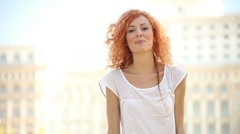Attractive Young Adult Woman Unbalances and Smiles Stock Footage
