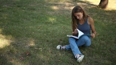 Pretty Young Adult Lady Studies in Park Stock Footage