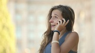 Pretty Young Lady Speaks on Cellphone and Smiles. Stock Footage
