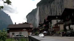 Lauterbrunnen, Switzerland with waterfall behind town. - stock footage