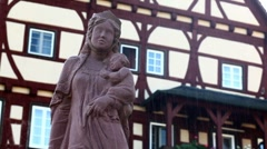 Statue and old building in rain Stock Footage