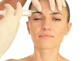 Stock Video Footage of Beautiful woman gets botox injection in her face, isolated on white NTSC