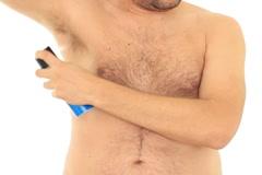Man applying deodorant, isolated on white NTSC Stock Footage