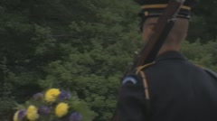 Stock Footage - Honor Guard Walking past wreath - Pan Stock Footage