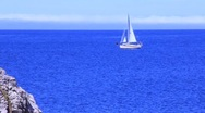 Stock Video Footage of Sailboat sailing across sapphire blue water (HD) k