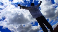 Stock Video Footage of Hands up to the blue sky filled with clouds