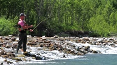 The fisherman and fly fishing Stock Footage