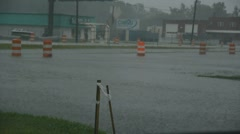 Hurricane Irene - Cars driving through flooded road - stock footage