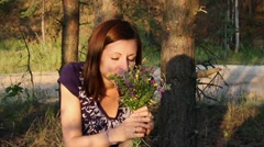 Girl With A Bouquet Of Flowers In The Forest 2 - stock footage