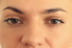 Close-up portrait of a female eyes, isolated on white NTSC Stock Footage