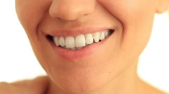 Smiling woman mouth with great white teeth close up, isolated on white HD - stock footage