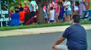 Man watching crowd at street party Stock Footage