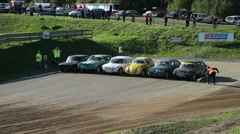 Start of a folkrace (autocross), pan Stock Footage