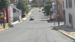 Stock Footage - Moving Vehicle - Small town scene Stock Footage