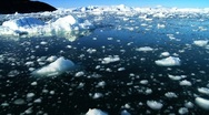 Stock Video Footage of Drifting by Icebergs Broken from Glaciers