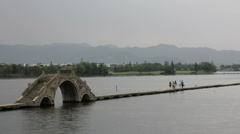Traditional Chinese Stone Bridge over River Stock Footage