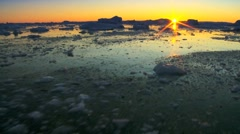 Arctic Sunset over Frozen Landscape Stock Footage