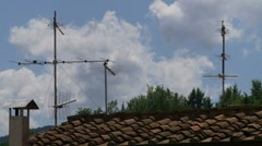 TV antennas in the roof time lapse 2 - stock footage