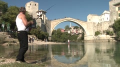 Fisherman by the Neretva river Stock Footage