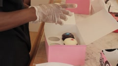 Stock Footage - Georgetown Cupcakes  - D.C. Cupcakes  Store - Filling order Stock Footage