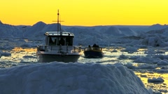 Nautical Vessel at Sunset in Ice Floes with Icebergs - stock footage