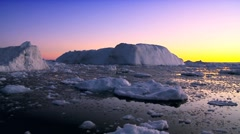 Dusk Over Icebergs & Ice Floes Stock Footage