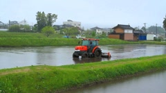 Tractor in a rice field. Stock Footage