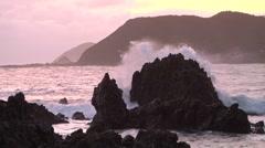 Rocky seashore at dusk Stock Footage