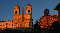 Rome Spanish Steps Church Trinita de Monti at dusk Stock Footage