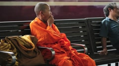 Young Monk Waiting for Train Stock Footage