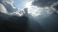 Majestic mountain landscape cloud timelapse withh sun rays Stock Footage