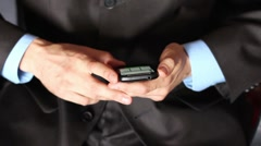 Businessman using mobile phone Stock Footage