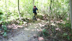 Biking on a trail in WV Stock Footage