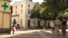 People walking by on sunny day Stock Footage