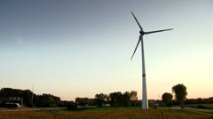 Wind Turbine next to a highway - stock footage
