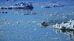 Small Craft Between Ice Floes Stock Footage
