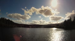 A timelapse of clouds moving over a beautiful lake HD Stock Footage