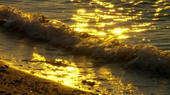 Small waves on shoreline at sunset Stock Footage