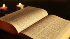 Old bible in half-light - stock footage