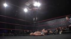 Pro wrestling match - Spinning top rope dive - Corkscrew splash HD Stock Footage