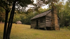 Old log cabin, dolly push in - stock footage
