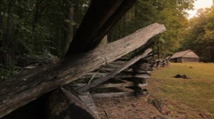Split rail fence, old barn, dolly right Stock Footage