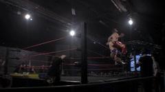 Pro wrestling match - 3 man top rope suplex HD - stock footage