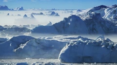Melting Ice Floes Between Icebergs Stock Footage