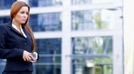 Adorable business woman using mobile phone outside office building Stock Footage