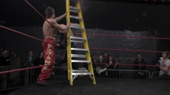 Pro wrestling moves - ladder match sequence, ladder hit & dropkick HD Stock Footage