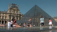 People sit in front of the Louvre in Paris. Stock Footage