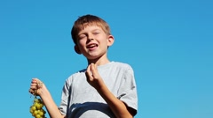 Boy eats a vine Stock Footage